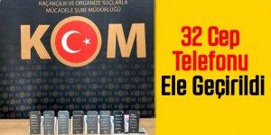 KOM'dan 4 ayrı adrese operasyon: 32 cep telefonu ele geçirildi